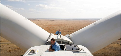 Technicians work to install a wind turbine in West Texas. (Photo credit: New York Times)